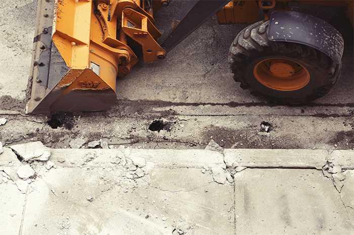 Cracked Sidewalk & Bulldozer